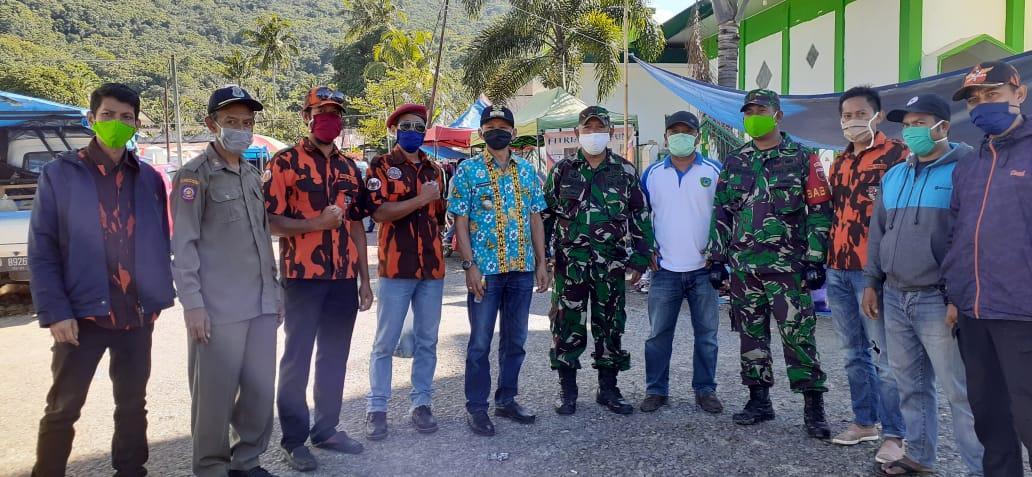 Gerakan Pencegahan Terus Digalakkan, Forkopincam Camba Bagikan Masker di Pasar